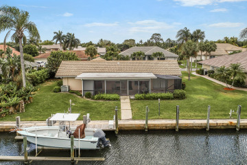 Home for Sale at 8967 SE Star Island Way, Hobe Sound FL 33455