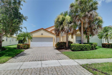 Home for Sale at 767 NW Mossy Oak Way, Jensen Beach FL 34957