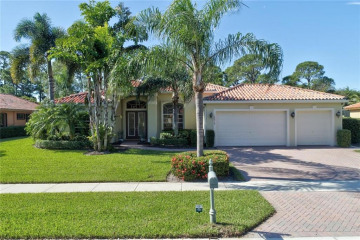 Home for Sale at 10014 SE Osprey Pointe Drive, Hobe Sound FL 33455
