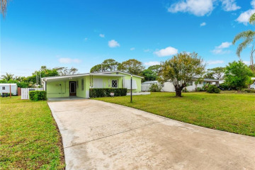 Home for Sale at 19036 SE Homewood Avenue, Tequesta FL 33469