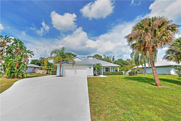 Home for Sale at 8815 SE May Terrace, Hobe Sound FL 33455