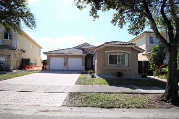 Home for Sale at 10944 NW 73rd St, Doral FL 33178