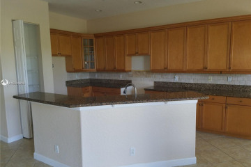 Home for Sale at 7884 NW 123rd Ave, Parkland FL 33076