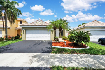Home for Sale at 1647 Palermo Dr, Weston FL 33327