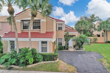Home for Sale at 6220 NW 77th Pl, Parkland FL 33067