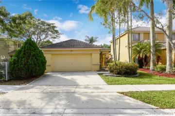 Home for Sale at 1163 Golden Cane Dr, Weston FL 33327