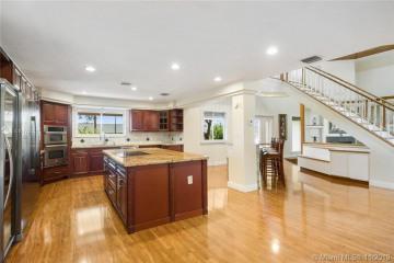 Home for Sale at 11900 Tara Dr, Plantation FL 33325
