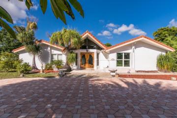 Home for Sale at 4915 Woodlands Blvd, Tamarac FL 33319
