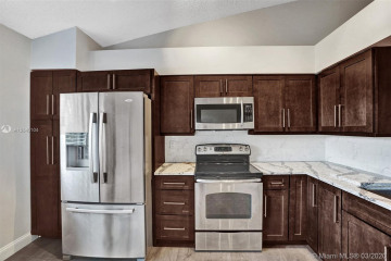 Home for Sale at 10542 NW 10th St #C-127, Plantation FL 33322