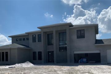Home for Sale at 3099 Lake Ridge Ln, Weston FL 33332