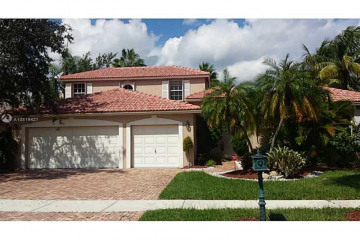 Home for Sale at 2459 Eagle Run Dr, Weston FL 33327