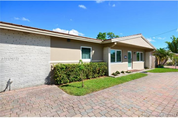 Home for Sale at 10829 N Snapper Creek Dr, Miami FL 33173