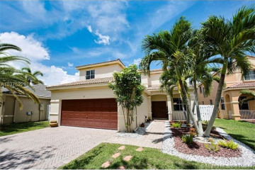 Home for Sale at 721 Tanglewood Cir, Weston FL 33327