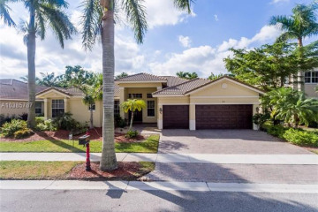Home for Sale at 973 Marina Dr, Weston FL 33327