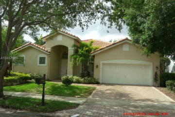 Home for Sale at 1374 Ginger Cir, Weston FL 33326