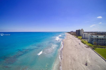Home for Sale at 100 Beach Road #903, Jupiter FL 33469