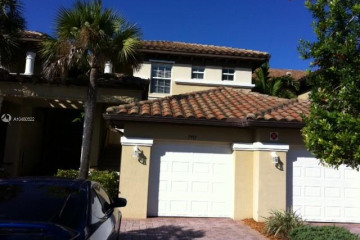 Home for Sale at 7991 NW 128th Ln #13-E, Parkland FL 33076
