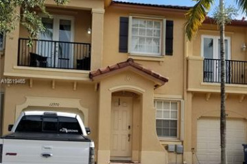 Home for Sale at 12970 SW 132nd Ter, Miami FL 33186