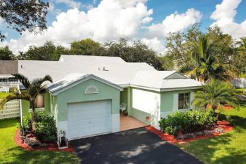 Home for Sale at 14564 SW 144th Ter, Miami FL 33186