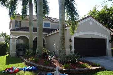 Home for Sale at 1650 Winterberry Ln, Weston FL 33327