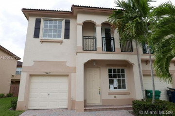 Home for Sale at 12819 SW 134th Ter #12819, Miami FL 33186