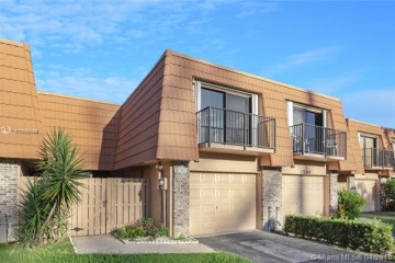 Home for Sale at 1502 W Harmony Lake Cir, Davie FL 33324