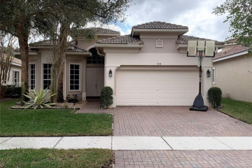 Home for Sale at 7214 NW 116th Way, Parkland FL 33076