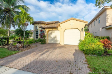 Home for Sale at 8225 NW 105th Ln, Parkland FL 33076