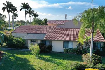 Home for Sale at 16791 Village Lake Dr, Weston FL 33326