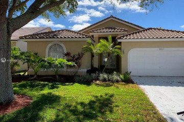 Home for Sale at 5964 NW 74th St, Parkland FL 33067