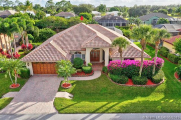 Home for Sale at 8900 SE Water Oak Place, Tequesta FL 33469