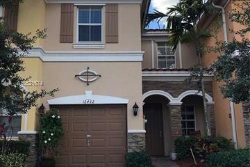 Home for Sale at 12432 Emerald Creek Mnr, Plantation FL 33325