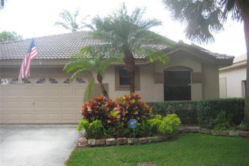 Home for Sale at 10300 NW 17 Court, Plantation FL 33322