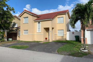 Home for Sale at 825 NW 126 Ct, Miami FL 33182