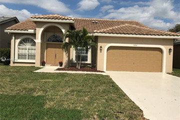 Home for Sale at 5887 NW 73rd Ct, Parkland FL 33067