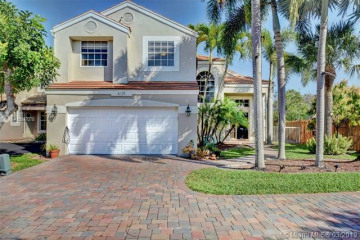 Home for Sale at 6125 NW 77th Pl, Parkland FL 33067