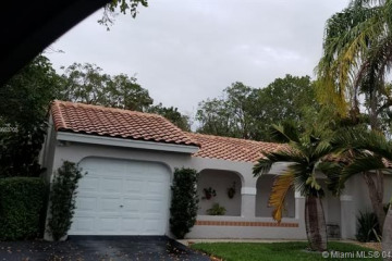 Home for Sale at 1443 Garden Rd, Weston FL 33326