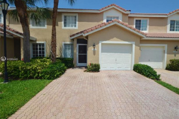 Home for Sale at 6243 NW 74th Ct, Parkland FL 33067