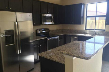 Home for Sale at 9606 N Town Parc Cir N, Parkland FL 33076