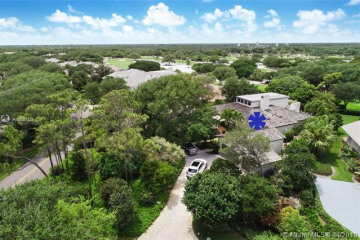 Home for Sale at 11812 SE Village Drive, Tequesta FL 33469