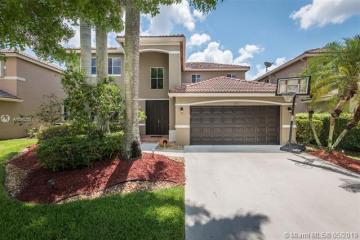 Home for Sale at 1017 Sunflower Cir, Weston FL 33327