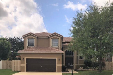 Home for Sale at 5740 NW 62 Manor, Parkland FL 33067