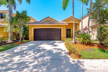 Home for Sale at 1121 Golden Cane Dr, Weston FL 33327