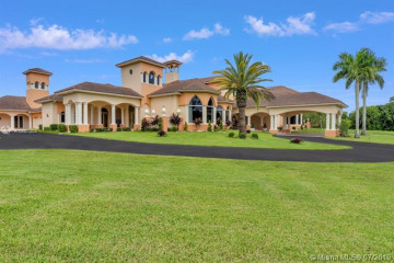 Home for Sale at 16260 Saddle Club Rd, Weston FL 33326