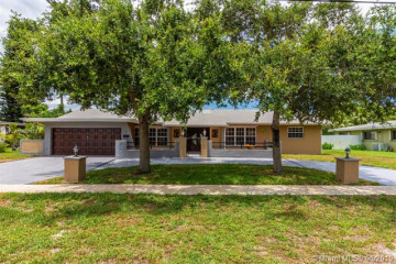 Home for Sale at 6591 NW 9th St, Plantation FL 33317
