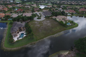 Home for Sale at 12060 NW 67 Ct, Parkland FL 33076