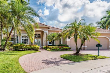 Home for Sale at 2530 Poinciana Dr, Weston FL 33327