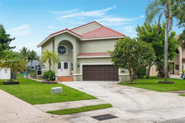 Home for Sale at 5931 NW 59th Ave, Parkland FL 33067