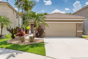 Home for Sale at 1210 Golden Cane Dr, Weston FL 33327