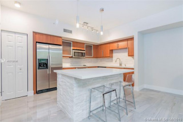 Home for Sale at 888 S Douglas Rd #105, Coral Gables FL 33134